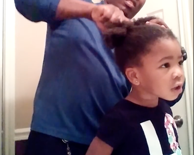 This Girl Encouraging Her Dad Doing Her Hair Is the Best Viral Video of the Weekend