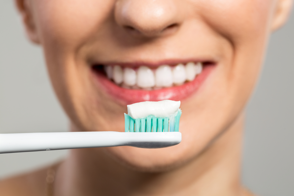 This New Toothpaste Ingredient Promises to Harden Teeth ...