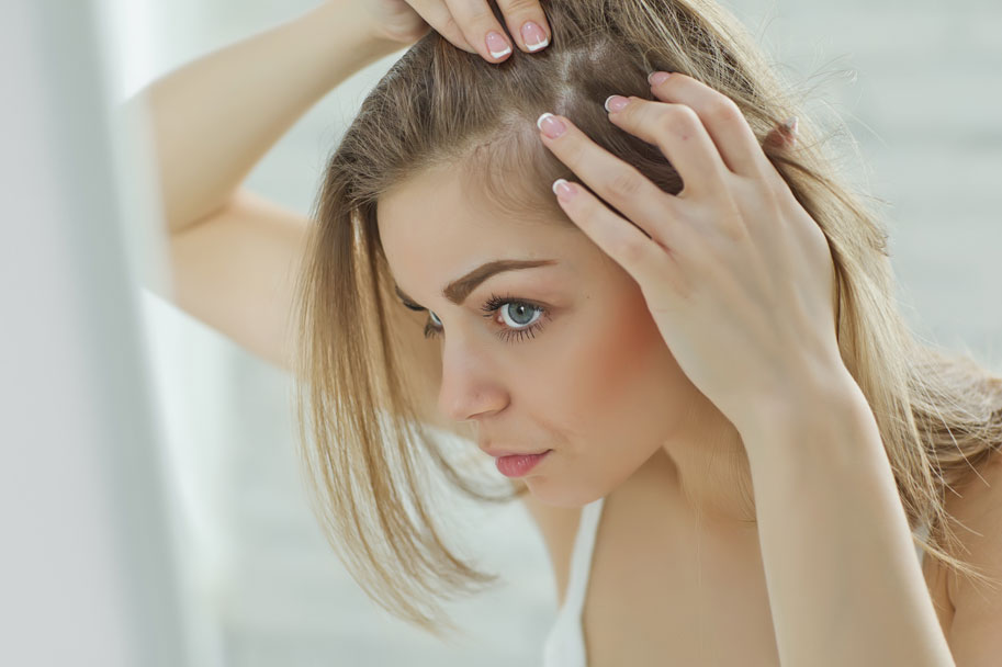 What It Means When You Get Breakouts On Your Scalp Hair