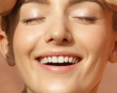 The Differences Between Veneers and Crowns, According to Dentists